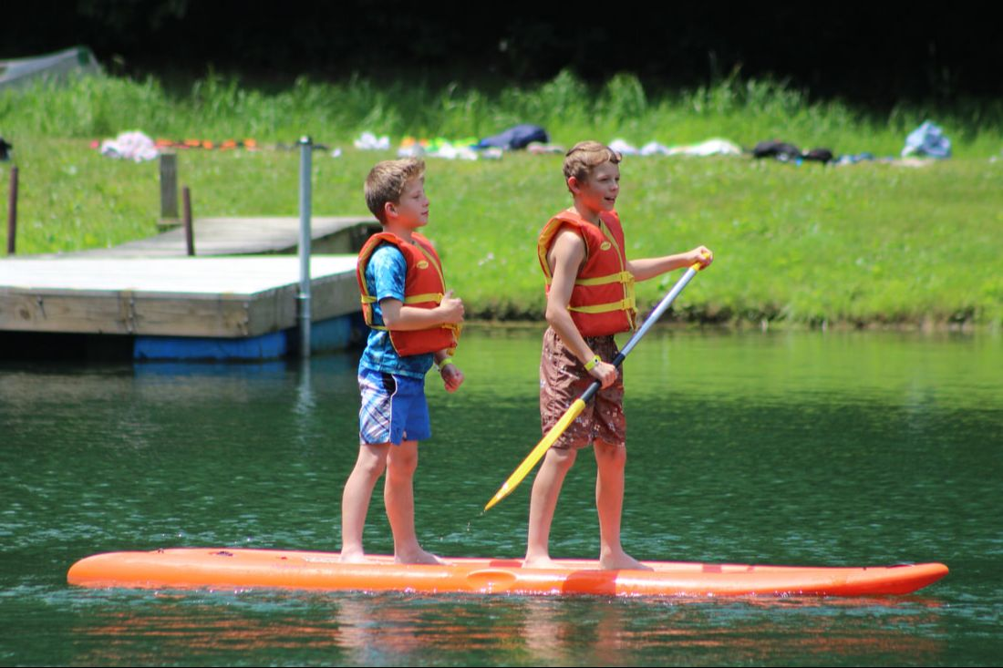 Campers on stand-up paddleboard